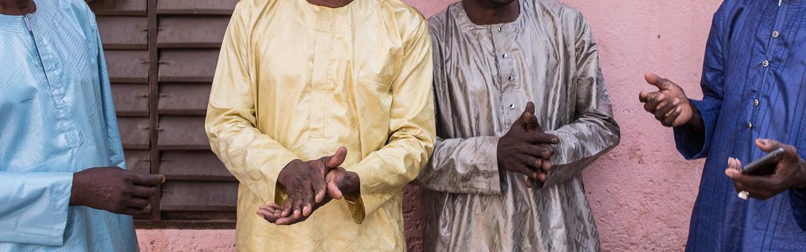People wearing DREWS guinea brocade